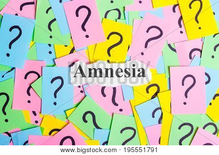 amnesia Syndrome text on colorful sticky notes Against the background of question marks