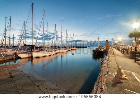 Yarmouth harbour on the Isle of Wight at sunset on a warm evening