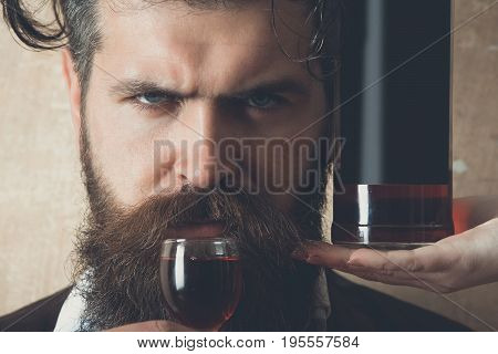 Man Drinking Wine From Glass With Bottle On Female Hand