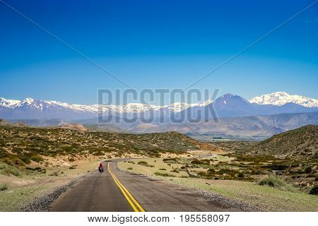 Woman cycling on the famous national Ruta 40   quarenta in central Argentina