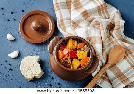 Pumpkin beef stew on a stone background
