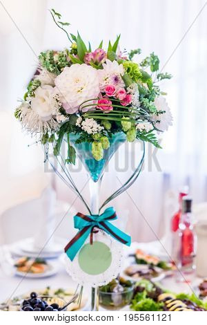 Festive wedding food table decorated with beautiful flowers. Wedding bouquet.
