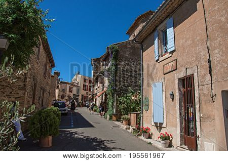 Gordes, France - July 03, 2016. Traditional stone houses on a street of the historical and lovely city center of Gordes. Located in the Vaucluse department, Provence region, southeastern France