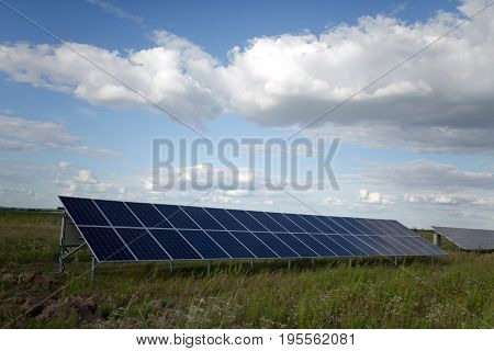 Solar energy panels in the field. View on a equipment on a solar energy power station.