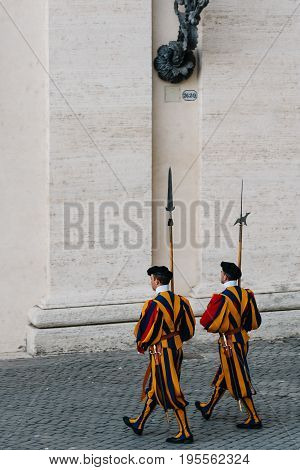 Rome Italy - August 19 2016: Papal Swiss guards making the changing of the guard. The Swiss guards served since the late 15th century.