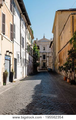 Rome Italy - August 20 2016: Via di San Francesco di Sales in picturesque neighbourhood of Trastevere in Rome a sunny summer day.