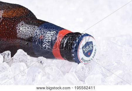 IRVINE CA - JULY 16 2017: Samuel Adams beer bottle closeup on ice. From the Boston Beer Company. Based on sales in 2016 it is the second largest craft brewery in the U.S.