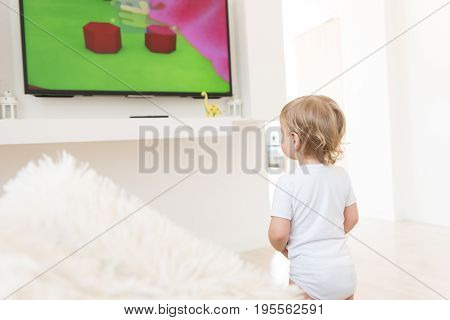 Cute Baby Boy Standing Up And Watching Cartoons.
