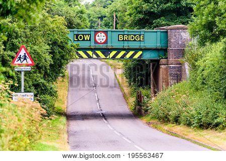 Day view of UK motorway highway under railway bridge.