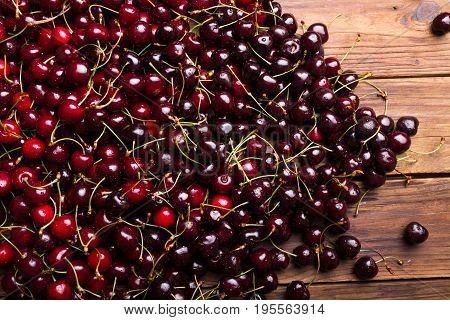 Ripe sweet cherry. Cherry. Cherry on a wooden background