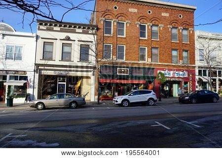 PETOSKEY, MICHIGAN / UNITED STATES - NOVEMBER 22, 2016: One may purchase shoes at Robert Frost Fine Footwear, books at McLean and Eakin Booksellers, and drink coffee at the Roast and Toast, on Lake Street in downtown Petoskey.