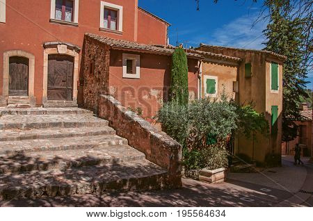 Roussillon, France - July 03, 2016. View of traditional colorful house in ocher and staircase, in the historic Roussillon. Located in the Vaucluse department, Provence region, southeastern France