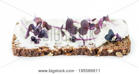Cream Cheese With Fresh Cress On A Slice Of Bread Isolated On White