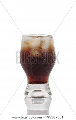 Soft Drink With Ice And Bubbles Isolated On White