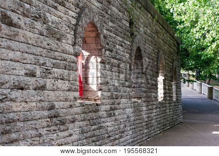 Stone wall with four archs along path