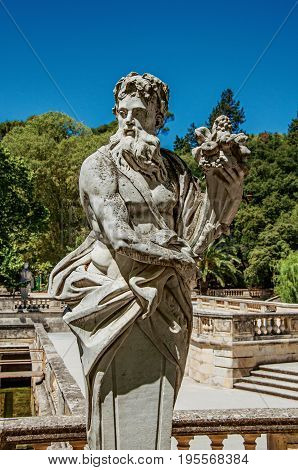 Close-up of a statue at the Gardens of the Fountain, in the city center of Nimes. Located in the Gard department, Occitanie region in southern France
