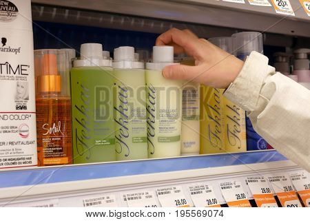 Coquitlam, BC, Canada - April 10, 2017 : People taking brilliant glossing shampoo inside Shoppers drug mart store