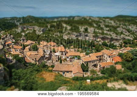 Baux-de-Provence, France - July 05, 2016. Baux-de-Provence castle ruins on the hill, with the roofs of the village below. Bouches-du-Rhône department, Provence region, southeastern France. Retouched photo