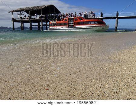 Ships' Tender Boat At The Pier, Doini Island, Papua New Guinea.