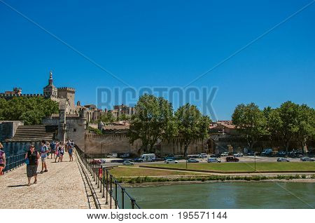 Avignon, France - July 06, 2016. View of the buildings of the historic center of Avignon, from Pont d'Avignon (bridge). Located in the Vaucluse department, region of Provence, southeast of France