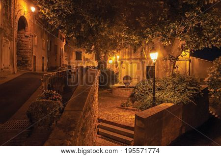 Châteauneuf-de-Gadagne, France - July 06, 2016. Night view of street and houses in the charming city center of Châteauneuf-de-Gadagne. Located in the Vaucluse department, Provence region, southeastern France