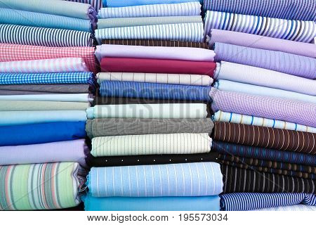 Neatly placed blue textile fabrics of textured texture backgrounds