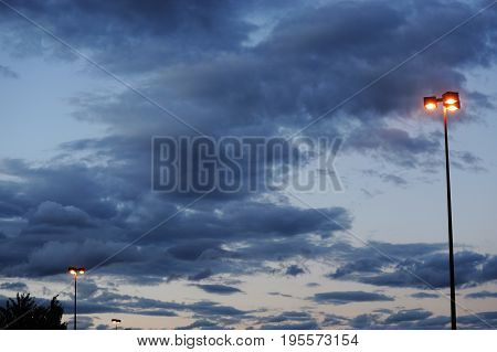 street lamp under dramatic storm cloudy sky