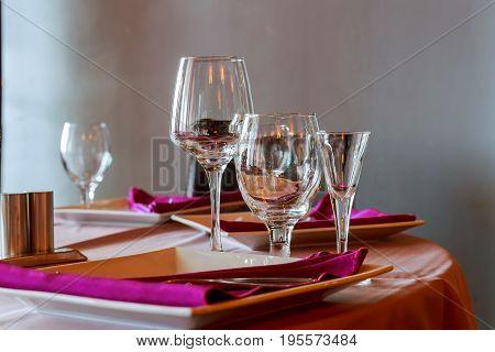 Glasses, Flower Fork, Knife Served For Dinner In Restaurant