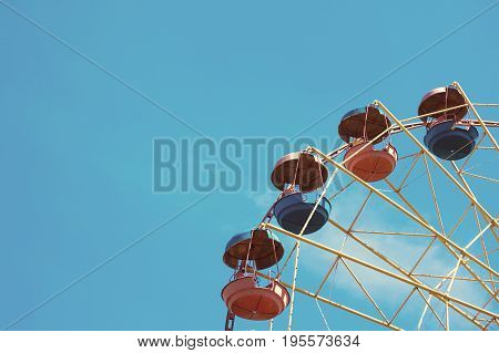 Wheel Display, On The Background Of Blue Sky.