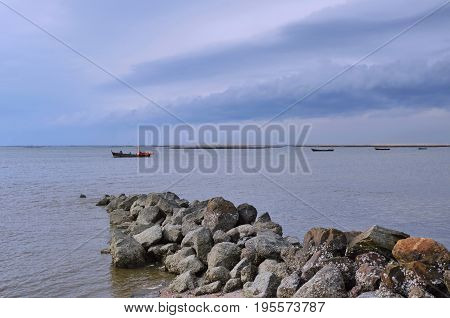 fishery boat ship from beach to the sea on sunset