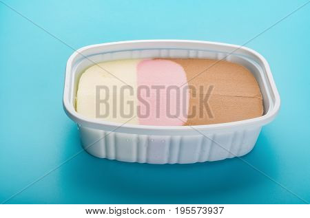 multi-color ice cream on blue background horizontal