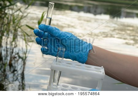 Taking a water test for analysis from a reservoir