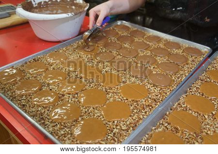 Pecan pralines and Milk Chocolate Gophers being made in a sweet shop in Savannah, GA
