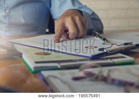 Business And Finance Concept Of Office Working, Businessman Discussing Analysis Chart, Vintage Effec