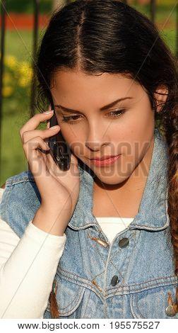 A Hispanic Teenage Girl And Mobile Phone