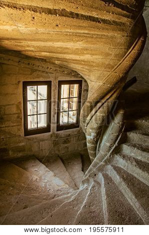 Lourmarin, France - July 07, 2016. View of stone staircase with dramatic light at Lourmarin castle, near the lovely village of Lourmarin. Vaucluse department, Provence region, southeastern France