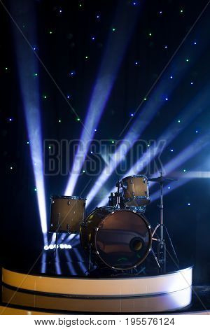 Modern drum set on stage in the spotlight color prepared for playing