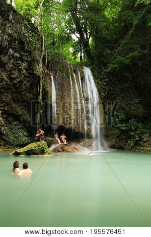 People Traveling And Bath In Erawan Waterfall, Thailand