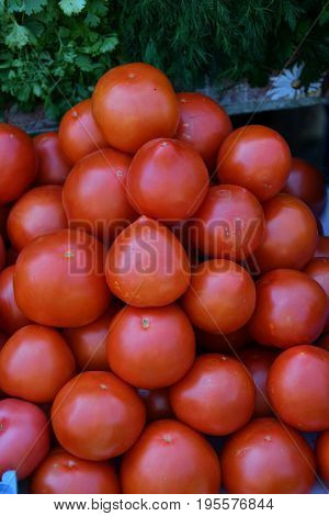 Ripe Tomatoes Are Sold At The Bazaar