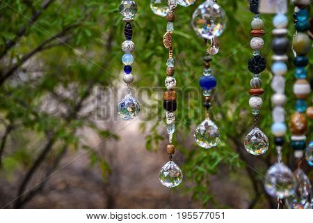 Beads hanging from a tree at a craft show