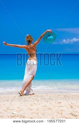 Woman on the beach in Porto Katsiki Lefkas Greece