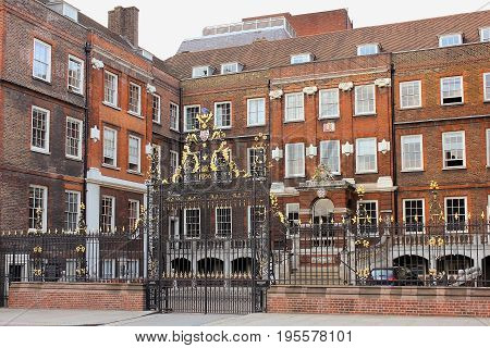 LONDON, ENGLAND - May 24,2017: decorative forged gates and main facade of the College of Arms, also known as the College of Heralds in London, UK