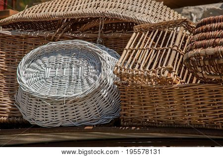 Close-up of colorful wicker baskets in the charming village of Moustiers-Sainte-Marie. In the Alpes-de-Haute-Provence department, Provence region, southeastern France