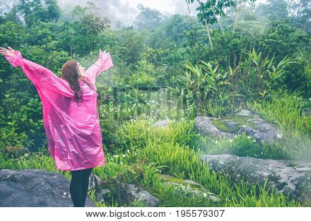 Asian women travel sleep relax. Morning atmosphere nature Forests. walk in the forest rainy season. puhinrongkla Thailand