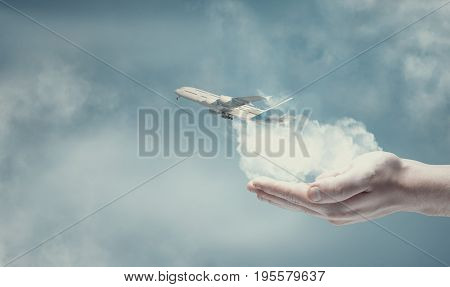 Plane taking off from a hand .