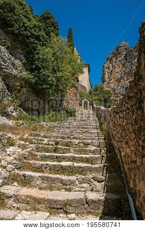 Close-up of stone staircase to the Notre-Dame de Beauvoir church, above the charming village of Moustiers-Sainte-Marie. In the Alpes-de-Haute-Provence department, Provence region, southeastern France