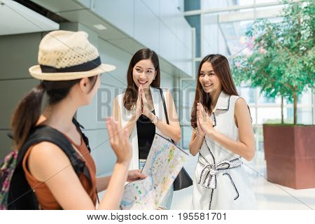 Tourist saying gooding to local people in Thailand
