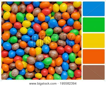 Pile of colorful chocolate coated candy. Colour palette with complimentary colour swatches