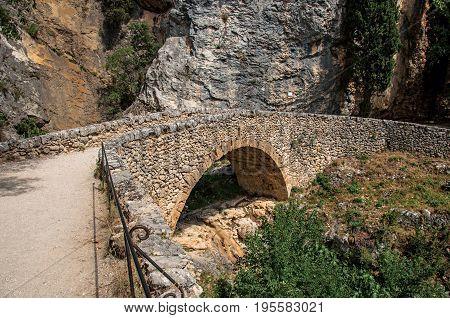 Close-up of bridge and path to the Notre-Dame de Beauvoir church, above the Moustiers-Sainte-Marie village. Alpes-de-Haute-Provence department, Provence region, southeastern France.