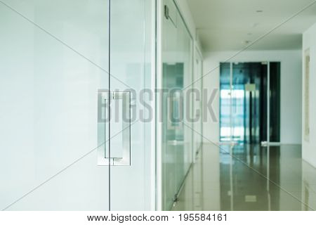 Modern office interior, selective focus on doorknob